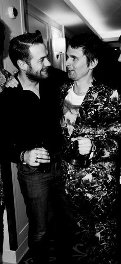 Tom Meighan and Matt Bellamy.