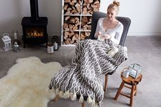 A beautiful Bernat Blanket tasselled throw that will keep you warm—Along with the cooler weather comes an undeniable urge to curl up under a handmade blanket.