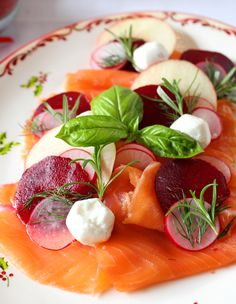 Fresh salmon starter with goat cheese, beetroot, apple and radishes