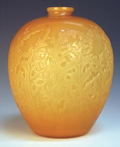 A Lalique butterscotch yellow |Acanthes| glass vase, introduced 1921, Marcilhac No. 902, the ovoid body moulded overall with acanthus leaves beneath a short cylindrical neck, intaglio moulded mark R. Lalique, height approx 28cm