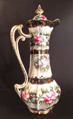 Nippon China Gilded & Hand Painted Art Nouveau Floral Chocolate Pot, circa 1900. Multicolor flowers, white background, black gilt.  Early 20th century china chocolate pot.