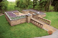 This raised bed garden is like something out of a movie.  Beautiful!