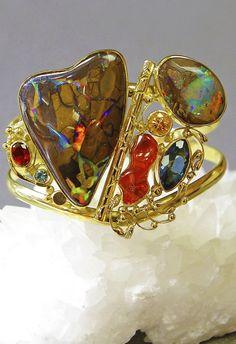 Jennifer Kalled, Boulder opal cuff bracelet accented with mexican opal, topaz, spessartite garnet, orange sapphire in 22k and 18k gold.  www.kalledjewelrystudio.com