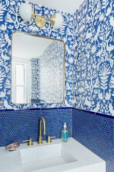 blue bathroom with penny tile backsplash