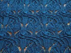 """Sinuous Art Nouveau! """"Rendezvous"""" by Lily Go - she does such elegant work with traveling stitches! Photos of 180+ project versions, in many yarns and with lots of comments."""