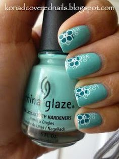 konad covered nails  pastel green with blue and white flowers