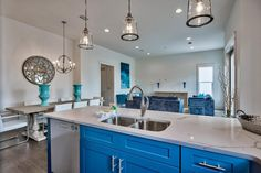 Quartz counters, blue cabinets