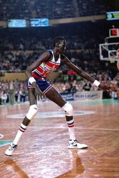 Manute Bol, who played for the Philadelphia 76ers from 1990 to 1993.