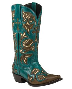 "Trinity is beautifully adorned with brass studs and crafted with a stunning turquoise-colored leather. Accented by a classic cross design, the detailing on these boots is unmatched they are sure to become your new favorite pair. Details include a snip toe, 1.5"" leather heel, pegged and nailed leather sole, mid-calf height, seam-covering inside shaft lining, and extra soft insole cushioning. These hand-fashioned boots have been carefully designed to be perfectly balanced with an emphasis on…"