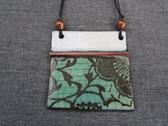 Items similar to Handmade pendant, green and white botanical copper enamel pendant, fold-formed copper, rustic copper beads, black waxed linen cord on Etsy