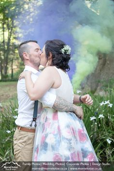 Bride in colorful floral dress giving her newly wed husband a big kiss with smoke bombs in the background #bride #groom #weddingcouple #justmarried #wedding #weddingphotography #weddingphotographer #weddinginspiration #beautifulbride Please like and repin. Also visit my website above for more photos and have a look at what I do. Please go and follow and like me on Facebook and Instagram Smoke Bombs, Newly Wed, Big Kiss, Just Married, More Photos, Wedding Couples, Beautiful Bride, Bride Groom, Wedding Inspiration