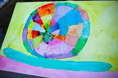 Watercolor snail…we made these today. So easy, so cute and so fun. The kids loved this craft and they are so colorful!