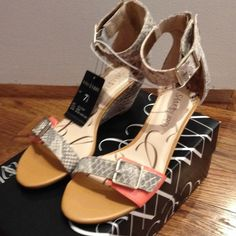 HP!!! 2/26NWT snakeskin sandal Host pick for the IT GIRL party 2/26/16 Open-toe sandals. Features cushioned footbed. Zipper on backs. Wide ankle strap with open/close buckles. Snakeskin  buckle on front, ankle strap, & snakeskin wedge heel! Natural snakeskin with a bit of coral in front. Sam & Libby Shoes Sandals