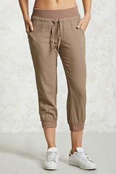 """Details A pair of linen joggers featuring a ribbed fleece knit trim, an elasticized waist with self-ties, slanted front pockets and buttoned back welt pockets. Content + Care - 55% linen, 45% viscose - Hand wash cold - Made in China Size + Fit - Model is 5'9"""" and wearing a Small - Inseam: 23"""" - Waist: 28.5"""" - Rise: 9"""" Product Code : 2000149567"""