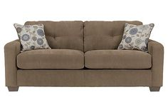 """The Kreeli - Toffee Queen Sofa Sleeper from Ashley Furniture HomeStore (AFHS.com). The smaller scale of the contemporary styled """"Kreeli-Toffee"""" upholstery collection features track arm styling along with the plush comfort of the boxed seat and back cushions adorned with tufting details to create living room furniture that captures exciting design without sacrificing comfort."""