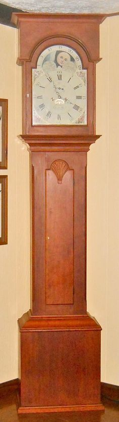 This is a reproduction I built of the long case clock at Shaker village Pleasant Hill, KY.  The original came to pleasant Hill in 1809 by a Virginia convert.  The works are by David Lindow and the dial was hand painted by Kathi S. at Dial House.  The wood is cherry with a hand rubbed finish.