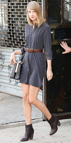 Taylor Swift styled her black prism-print Equipment shirt dress with a brown leather belt, her go-to Dolce & Gabbana handbag and dark ankle boots.
