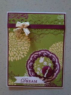 Serene Silhouettes (127324 clear), Gossamer Lace (129050 wood) and Loving Thoughts (125845 clear) stamp sets with Floral District Designer Paper (126919) for my background.  I love Rich Razzleberry and so I accented the card with a piece of ribbon and a button in that color as well as the ink(126950) to stamp my image and word in.