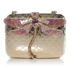 This is an authentic GUCCI Metal Guccissima Dragonfly Minaudiere Clutch in Gold.   This stunning evening clutch is crafted of light gold metal set with the Gucci GG monogram.