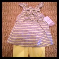 Carter's 2 piece girls outfit size 6 months Adorable grey and yellow ruffle sleeveless top with matching yellow Capri leggings. Size 6 months. Carter's Other