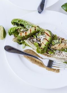 Burnt Romaine with Grilled Avocado, Tomatillos, & Cotija Cheese