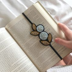 Treat yourself to a cup of tea, a new book and this pretty bookmark. The flat black elastic slips into your book, holds your pages perfectly and fits most books. The back of the bookmark is finished with the same felt. PLEASE NOTE: This item is made to order. Please check the shipping and
