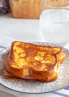 A U.S. variation on the French Croque Monsieur; it is a grilled ham and cheese sandwich (typically made with emmental or gruyere cheese), dipped in egg batter and pan-fried until golden brown, similar to French toast. It can be served as a savory dish, as described above, or as a sweet dish, topped with powdered sugar and served alongside berry preserves for dipping.
