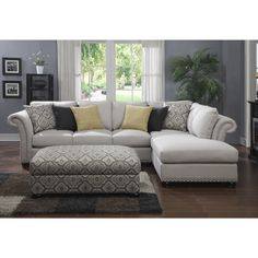 This Sectional is covered in a soft, textured fabric, and features design details such as welted reversible back cushions. Slightly flared, rolled arms and brushed nickel nails accentuate the arms and base.
