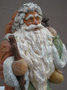 Hand Carved Santa Old World Style Walking in the by justingordon