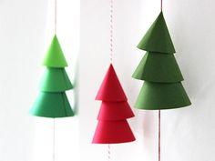 Make a DIY Paper Christmas Tree Garland >> http://blog.diynetwork.com/maderemade/how-to/diy-paper-christmas-tree-garland/?soc=pinterest