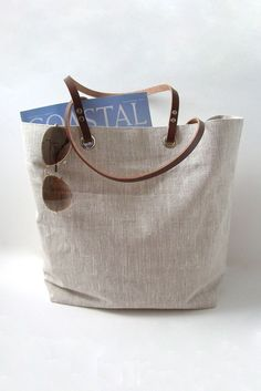 This natural, textured linen tote bag is lightweight yet super durable...and the neutral oatmeal color goes with just about anything! Go ahead and stuff this bag with beach towels, books and laptops..