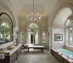 Traditional master bathroom with tray ceiling, arched transom windows, a drop-in tub and a chaise lounge by the French double doors. bathroom chandelier 80 Master Bathrooms with Chandelier Lighting (Photos) Luxury Master Bathrooms, Dream Bathrooms, Beautiful Bathrooms, Luxurious Bathrooms, White Bathrooms, Home Design, Design Ideas, Design Inspiration, Transom Windows