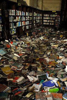 An abandoned library in Detroit. Such a waste :(       How does this happen?  So many people would love to have these books.  :(
