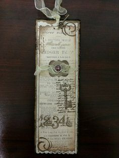 Bookmark in Brown and Gold with Compass Brad, Tag, Scrolls and Ribbon Topper
