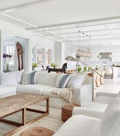 Beautiful coastal cottage living room drench in natural light and neutral tones