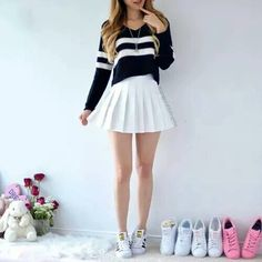A black sweater with white stripes, featuring a white pleated skirt and Superstar sneakers. A black sweater with white stripes, featuring a white pleated skirt and Superstar sneakers. Girls Fashion Clothes, Teen Fashion Outfits, Girly Outfits, Cute Casual Outfits, Skirt Outfits, Cute Fashion, Outfits For Teens, Pretty Outfits, Stylish Outfits