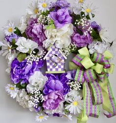 Thanks so much for stopping by and visit my creations. All my wreath is unique and created in highest quality. This beautiful Spring, Easter flower door wreath sets on a nature grapevine wreath base. The wreath is embellished with lots of greenery, beautiful lavender and white Peonies, lavender Roses , and white, lavender Hydrangeas. The wreath is accented with a hand painted lavender/white check Bird House with a lovely lavender bird . I finish the wreath with a lavender/lime gre...