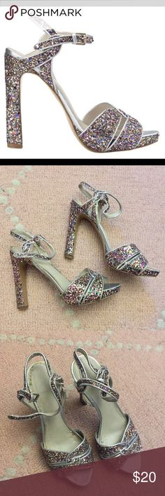 Nine West Glitter Sparkly Sandals Heels 7.5 Pre-Loved Nine West Glitter Multi-color Heels Size 7.5.  Wonderful cocktail party shoes. Platform, thick heel, pumps, strapped.  This is a used item, so please make sure you check out the photos and are okay with the flaws prior to purchasing, thank you!  Free shipping if you purchase 3 or more listings from my shop! Just bundle and I will offer free shipping!  Please let me know if you have questions! Nine West Shoes Heels