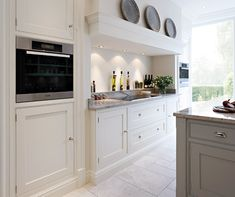 Great stove lighting and makes a feature out of a small stove, Contemporary Shaker Kitchen by Tom Howley