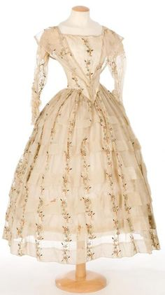 A dress made of barege, which is a light and somewhat sheer wool and silk fabric blend seen in outerwear during the Crinoline period.