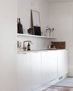 Minimalist white kitchen - kitchen open shelving - kitchen styling