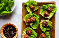 Take on the takeout with healthy meatball lettuce wraps starring extra-moist baked Asian chicken meatballs.