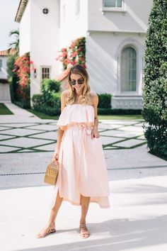 Little Blonde Book A Fashion Blog by Taylor Morgan: Just Peachy. Peach strapless midi dress+beige straps flat sandals+wood handbag+sunglasses+peach tassel earrigns. Summer Casual Outfit 2017