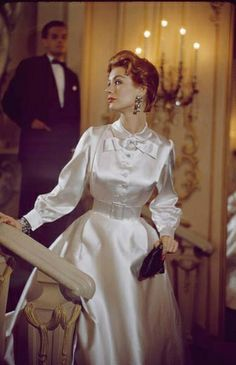 white satin evening dress by Jane Derby, photo by Nina Leen vintage fashion style color photo print ad white satin evening dress gown high collar long sleeves buttons full skirt cocktail dress? Vintage Fashion 1950s, Fifties Fashion, Vintage Couture, Vintage Mode, Retro Fashion, Vintage Dior, Edwardian Fashion, Vintage Hats, Gothic Fashion