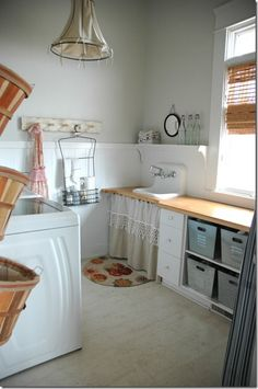 "favorite laundry room! (from homeandharmony) dropcloth (""poor man's linen"") lined lampshade, linen/lace skirted vintage sink, little round mirror, ruffly apron, orchard baskets for laundry, neutral, bright"