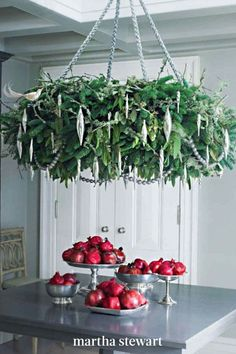 When suspended from the ceiling, this impressive, ornament-laden ring of greens will thrill your guests. Its wild, earthy look comes from the tangle of lichen branches and seeded eucalyptus. Follow our step-by-step tutorial for this holiday wreath. #marthastewart #christmas #diychristmas #diy #diycrafts #crafts
