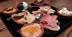 Mediterranean Tapas, traditional hummus, prosciutto, Catalan meatballs, roasted butternut squash hummus, marinated feta, Moroccan spiced lamb kebab, and grilled pita | Green Valley Grill | Greensboro, NC