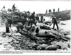 Pz.Kpfw III being dragged out a river after breaking through the ice