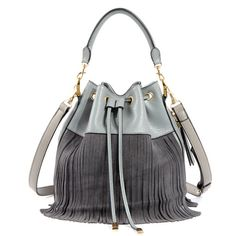 One of the hottest trends in 2016 are the bucket bags. We just got a hold of the new cross-body designer leather bucket bag decorated with fringes. Large capacity with interior slot and cell phone poc