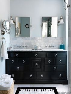Editor Zim Loy painted a vintage dresser black, added Creations ring pulls from Alno for a campaign-chest look, and turned it into a master bath vanity for her Italianate house in Kansas City, Missouri.  She also fitted the piece with shallow Cheviot Estoril drop-in sinks, so even the top drawers are usable.